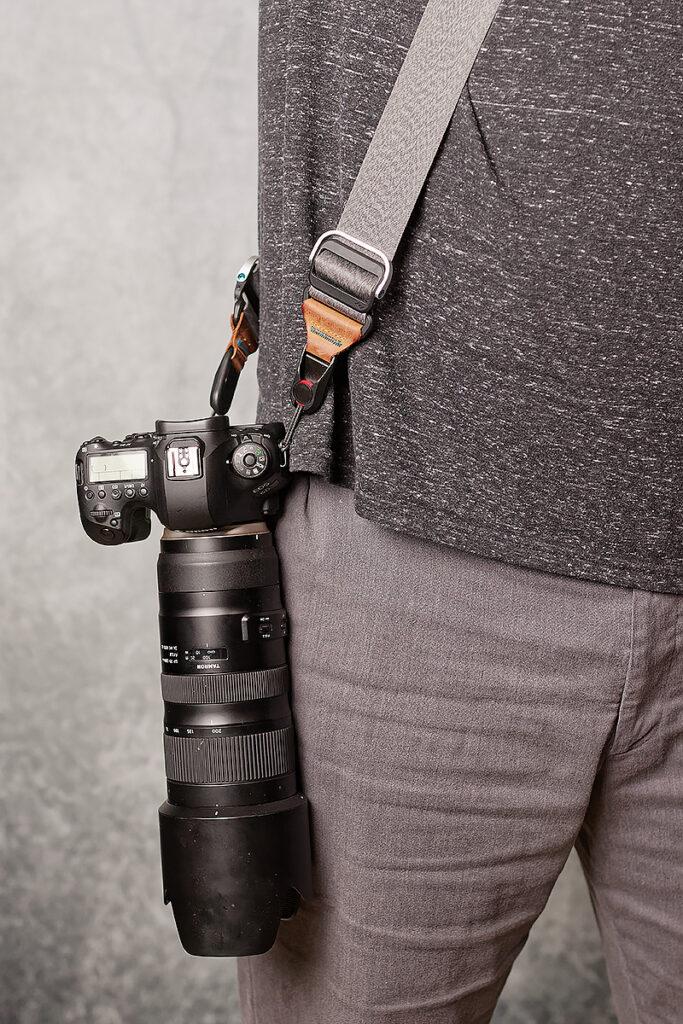 peak design slide holding camera and 70-200mm lens